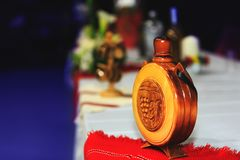 Wooden bottle with national symbols graven on wood traditional Royalty Free Stock Photos