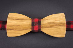 Wooden bow tie on a table Stock Images