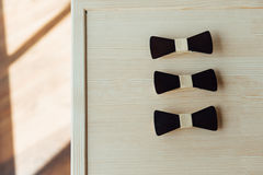 Wooden bow ties on a ivory table Stock Image