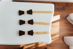 Wooden bow ties on a ivory table Royalty Free Stock Image