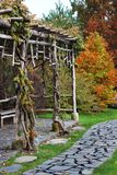 Wooden bower in autumn garden Stock Photo