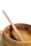 Wooden Bowl. A spatula resting in an empty wooden bowl, with a solid white background Royalty Free Stock Photography