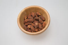 Wooden bowl with almond Stock Photography