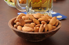 Wooden bowl of almonds Royalty Free Stock Photo