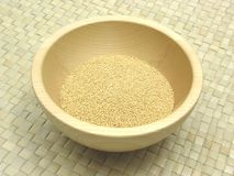 Wooden bowl with amaranth. On rattan underlay Royalty Free Stock Photography