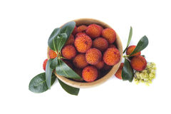Wooden bowl with arbutus unedo fruits Stock Photography
