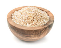 Wooden bowl of barley grits Stock Photo