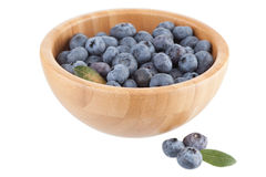 Wooden bowl with bilberry berries Stock Photos