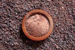 Wooden bowl on black salt background Stock Images