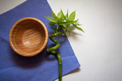 Wooden bowl on blue Royalty Free Stock Images
