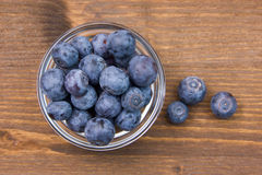 Wooden bowl with blueberries on top Royalty Free Stock Photos
