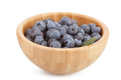 Wooden bowl with blueberry berries Royalty Free Stock Photos
