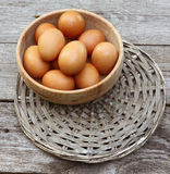 Wooden bowl with the brown eggs Royalty Free Stock Photo