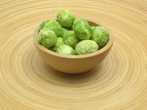 Wooden bowl with brussels sprouts Royalty Free Stock Image