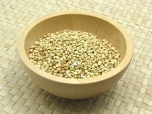 Wooden bowl with buckwheat Royalty Free Stock Images