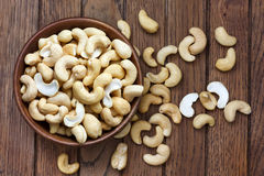 Wooden bowl of cashew nuts from above. Royalty Free Stock Image