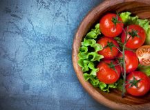 Wooden bowl with cherry tomatoes Stock Photography