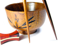 Wooden bowl and chopsticks. Suggestion-over white background Royalty Free Stock Image