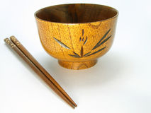 Wooden bowl and chopsticks Stock Images