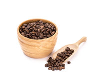 Wooden bowl with coffee beans Stock Images