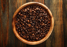 Wooden bowl with a coffee beans Stock Photo