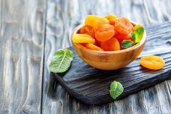 Wooden bowl with dried apricots. Royalty Free Stock Photos