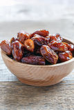 Wooden bowl with dried date fruit. Stock Photo