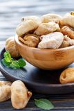 Wooden bowl with dried figs. Royalty Free Stock Photos
