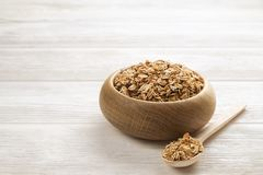 Light carbohydrate and protein rich granola all-day energy breakfast. A wooden bowl of dried fruit and nuts trail mix with almonds, raisins, seeds, cashew Stock Photos