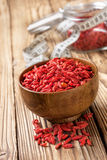 Wooden bowl with dried goji berries Royalty Free Stock Photo