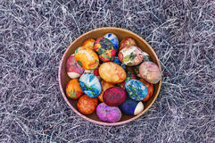 Wooden bowl with easter eggs stock photos