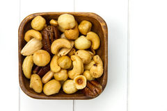 Wooden bowl filled with nuts Royalty Free Stock Photos