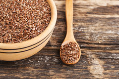 Wooden bowl and flax seed Royalty Free Stock Image