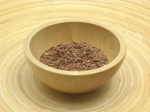 Wooden bowl with flaxseed Royalty Free Stock Image