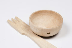 Wooden bowl and fork Royalty Free Stock Photos