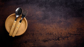 Wooden bowl ,fork and spoon Royalty Free Stock Photos