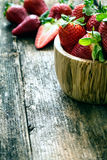 Wooden bowl of fresh strawberries Stock Images