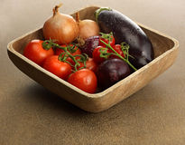 Wooden bowl with fresh vegetables Royalty Free Stock Photography