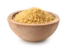 Wooden bowl full of bulgur stock image