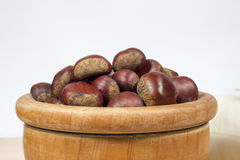 Wooden bowl full of chestnuts Stock Photos