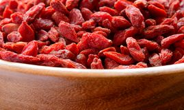 Wooden Bowl Full of Dried Goji Berries Stock Images