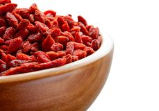 Wooden Bowl Full of Dried Goji Berries on the White Table Royalty Free Stock Images