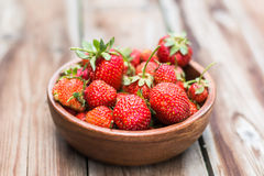 Wooden bowl full of fresh strawberries. On thewooden background selective focus Stock Photography
