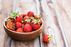 Wooden bowl full of fresh strawberries. On thewooden background selective focus Stock Image