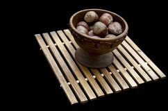 Wooden bowl full of hazel nuts Royalty Free Stock Image