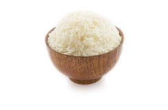 Wooden bowl full of Jasmine rice on white background Stock Photos