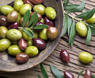 Wooden bowl full of olives. Stock Photography