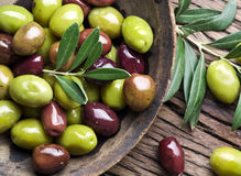 Wooden bowl full of olives. Royalty Free Stock Image