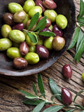 Wooden bowl full of olives. Royalty Free Stock Photography
