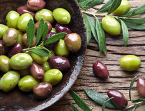 Wooden bowl full of olives. Stock Photo